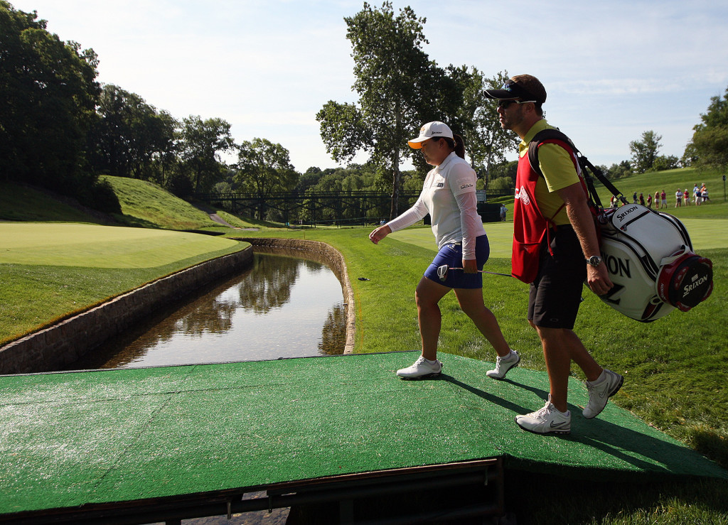 Inbee Park, and her caddie walk onto the 12th green, during second day action of the 70th US Women's Open at Lancaster Country Club Friday July 10, 2015. (Photo/Chris Knight)