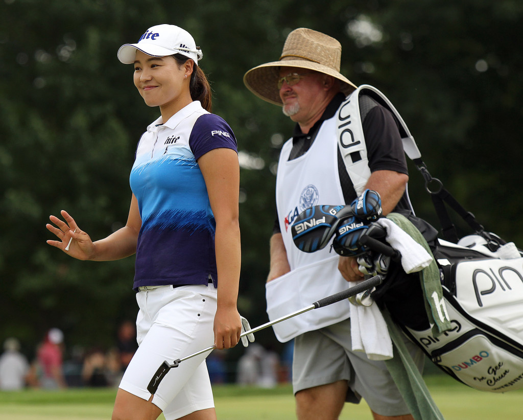 In Gee Chun, waves to the crowd as she walks onto the 1st green, during final day action of the 70th US Women's Open at Lancaster Country Club Sunday July 12, 2015. (Photo/Chris Knight)