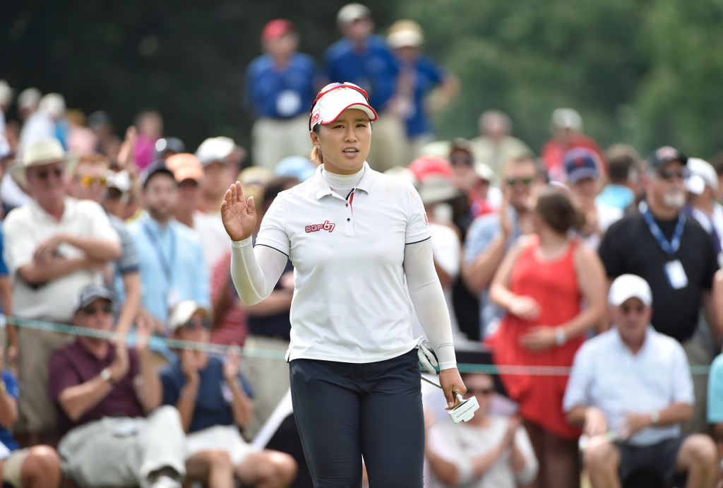 Amy Yang acknowledges the crowd after a putt on the eighth hole during the final round of the US Women's Open at Lancaster Country Club on Sunday, July 12, 2015. (Photo/Suzette Wenger)