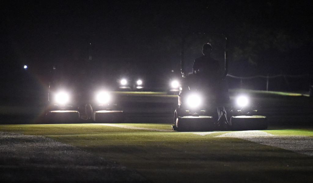 With headlights on their mowers members of the Grounds Crew cut the grass on the number one fairway at Lancaster Country Club shortly after 5:00 a.m. to prepare the course for the third day of the U.S. Women's Open.  (Photo/Blaine Shahan)