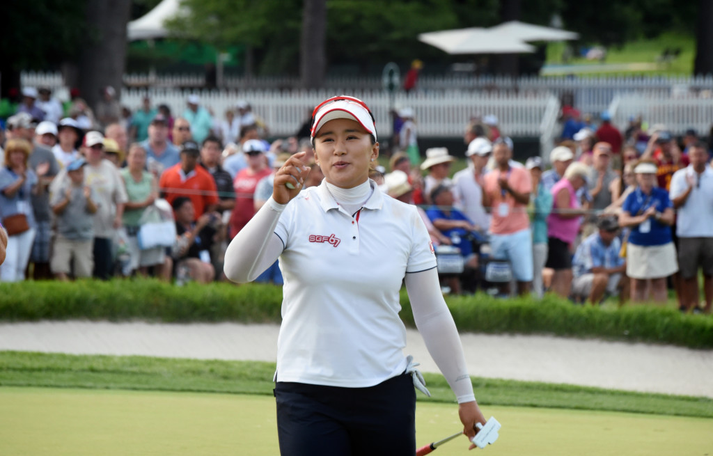 Amy Yang waves to the crowd after finisher the final round of the 2015 U.S. Open with a bogey 18 to finish second.